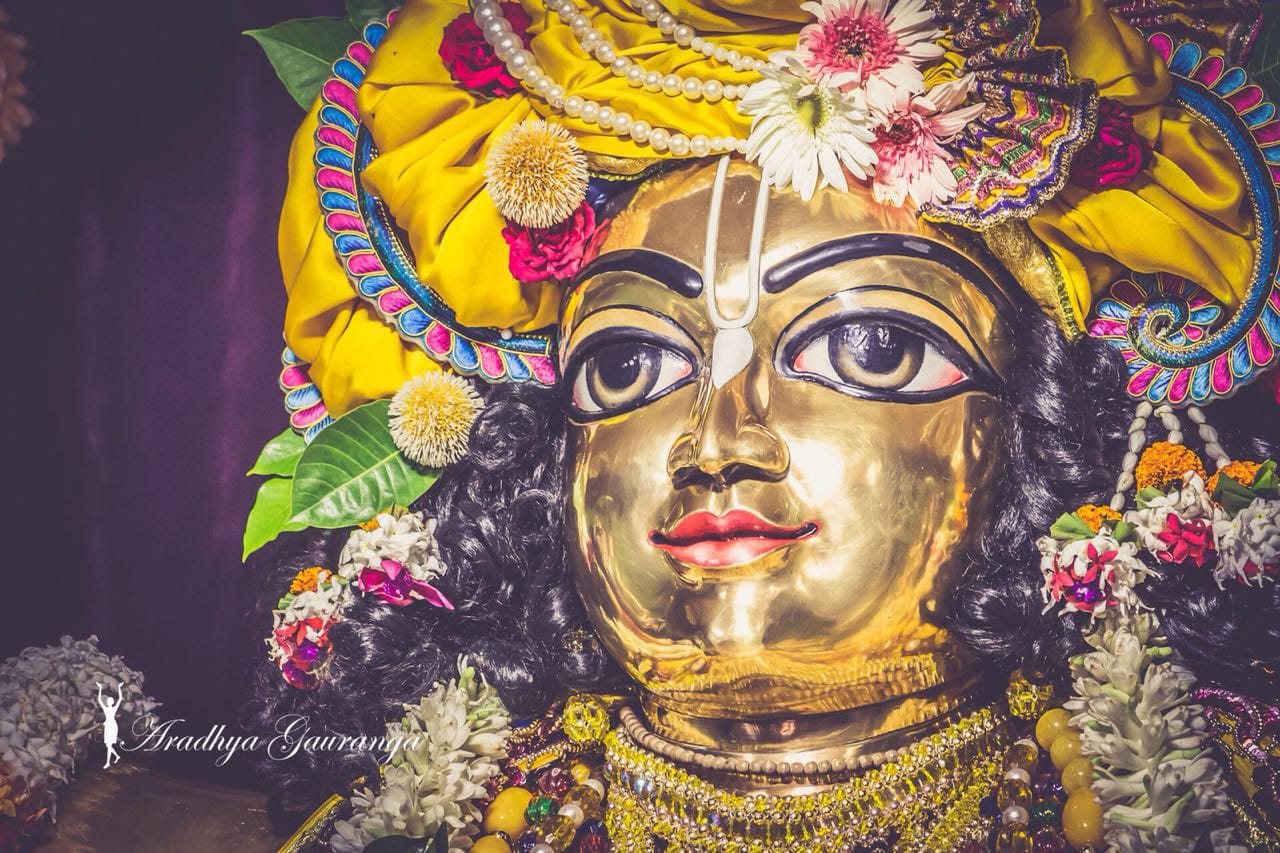 golden statue of krishna